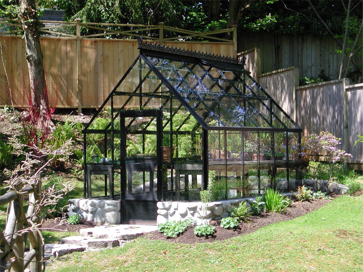 Cape cod glass greenhouse gothic arch greenhouses for Build a green home