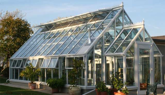 Custom luxury greenhouses garden greenhouse kits for Green home building kits