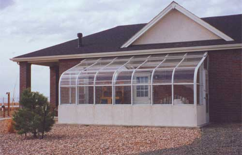 Grand hideaway glass greenhouse gothic arch greenhouses for House plans with greenhouse attached